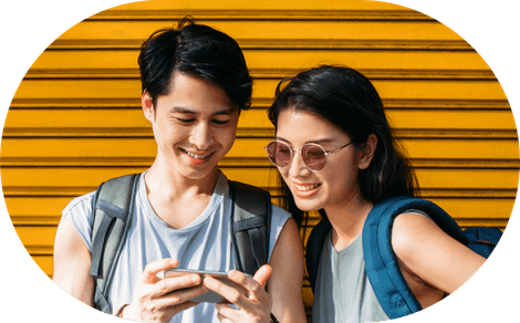 A couple using a phone together.