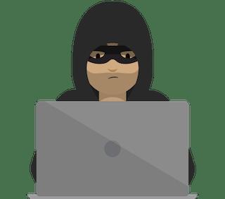A hacker working on a laptop