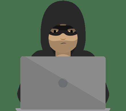 デスクトップで作業するハッカー。