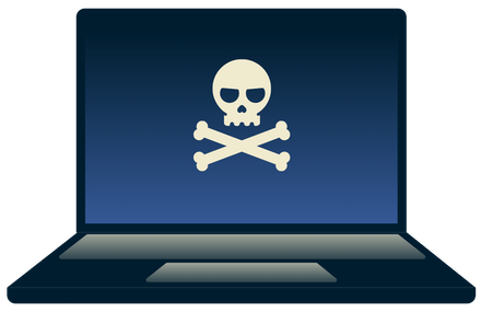 En hacker som jobbar på en laptop.