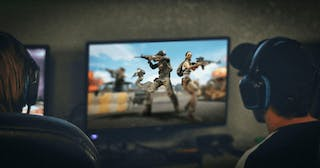 Someone playing PUBG at home with a gaming console.