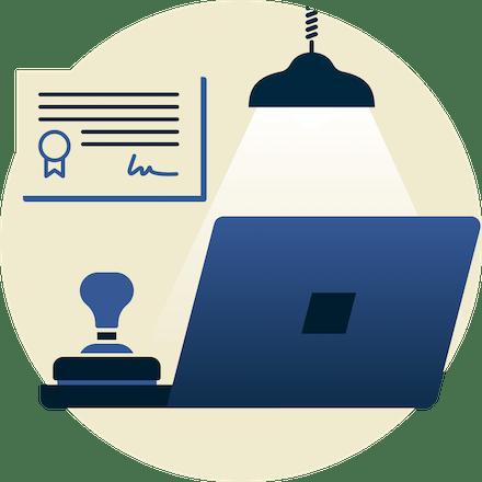 Lampe sur un tampon en caoutchouc et un ordinateur portable, avec un certificat en arrière-plan