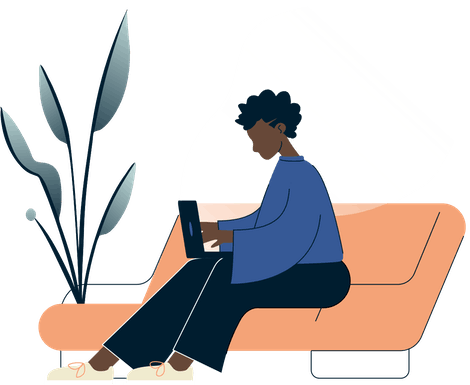 Woman using a laptop on the couch.